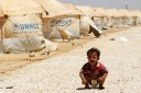 A Syrian refugee child cries at the Al Zaatri refugee camp in the Jordanian city of Mafraq, near the border with Syria