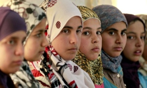 Syrian refugee girls sit at the United N